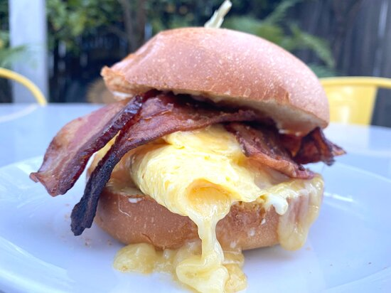 Bacon, Egg, & Cheese Sandwich Folded egg, cheddar cheese, applewood smoked bacon, and garlic aioli on toasted brioche.