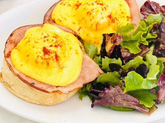 Eggs Benedict poached eggs, Duroc ham, lemony hollandaise, english muffin, French vinaigrette dressed lettuces