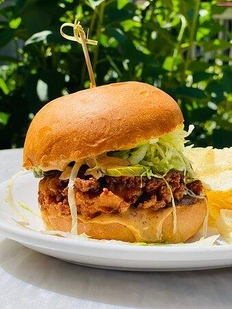 Crispy Chicken Sandwich  crispy chicken thigh, pickles, shredded lettuce, special sauce on a brioche bun