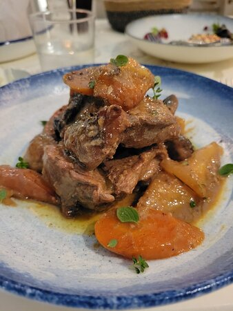 Pork marinated in honey, mustard and rosemary , with fresh mushrooms , carrot and potatoes