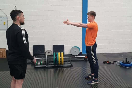 John McCormack in one of his personal training sessions is called fitness testing. He is testing the client's flexibility.