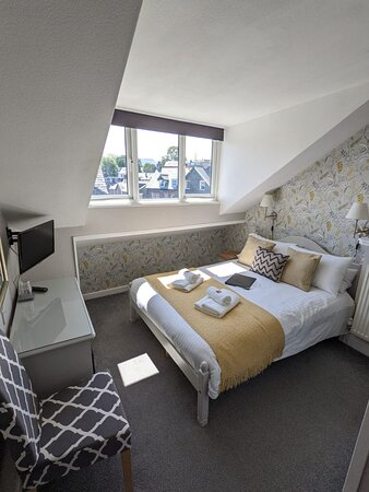 Top floor attic double room with en suite and views across the rooftops to Causey Pike and Cat Bells.