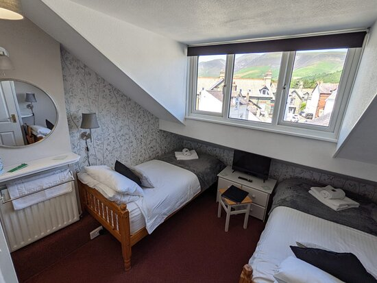 Twin attic room with views of Skiddaw, Blencathra and Latrigg.  Compact twin with en suite.