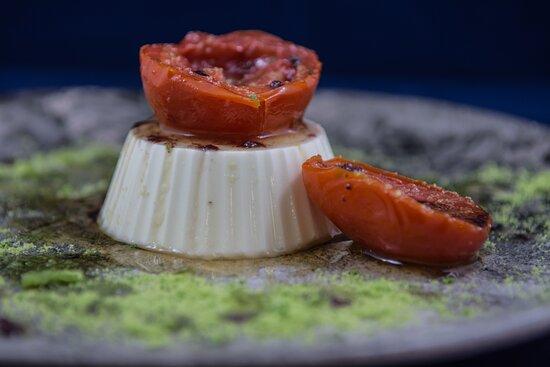 Panna Cotta feta  Feta cheese, semi-dried tomato, maple syrup, black olives oil and parsley powder
