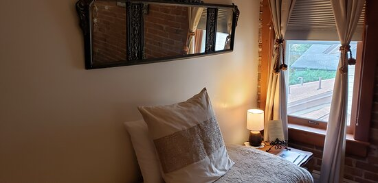 Day bed with antique mirror above, Apple Blossom Rm.