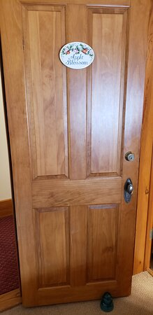 Gorgeous wooden doors with room name plaques.