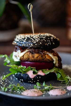 Food made with local, organic and ethical produce. This is our Vegetarian mushroom and black bean burger!