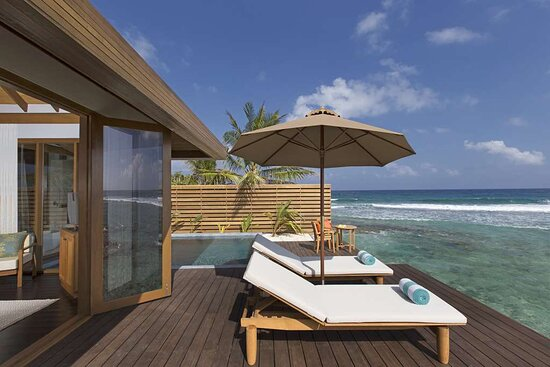 Exterior view of Ocean Pool Bungalow deck with sun-loungers and swimming pool