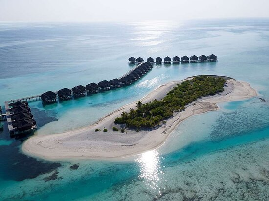 Aerial shot overlooking the overwater bungalows and Moyo Island