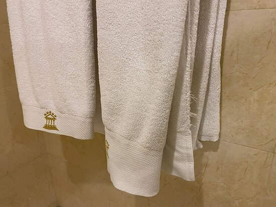 Bath towels are rotten and torn.