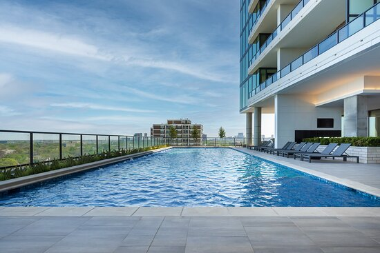 Take a refreshing dip into our oversized pool on the 10th floor of The Tower, with sweeping views of the city and Downtown Houston.
