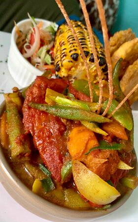 Thai curried fish served with roasted corn & pressed plantains. @pizzazzfusionja