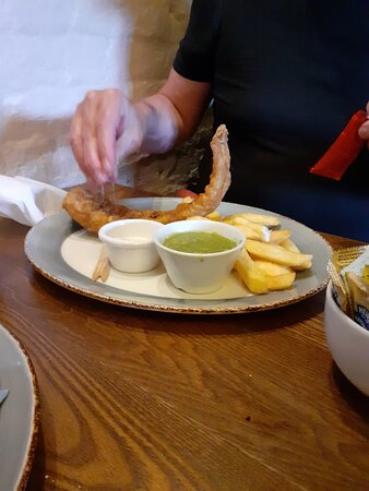 Fish and chips with mushy peas but a bit mean on the chips