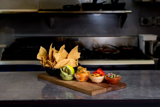 The Chips with Dips Entrada! Enjoy some housemade chips with either one or all of the following dips: guacamole, queso, or salsa.