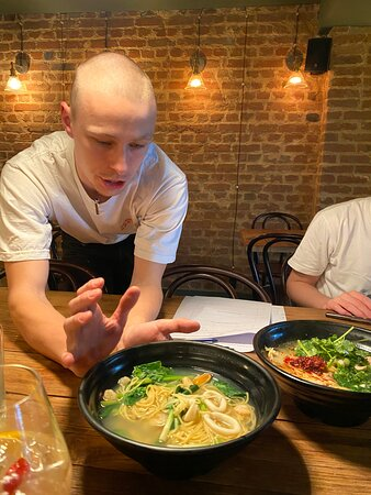 Our chef with the Galangal Ramen. The ramen can be ordered with chicken, prawns, or vegetables.