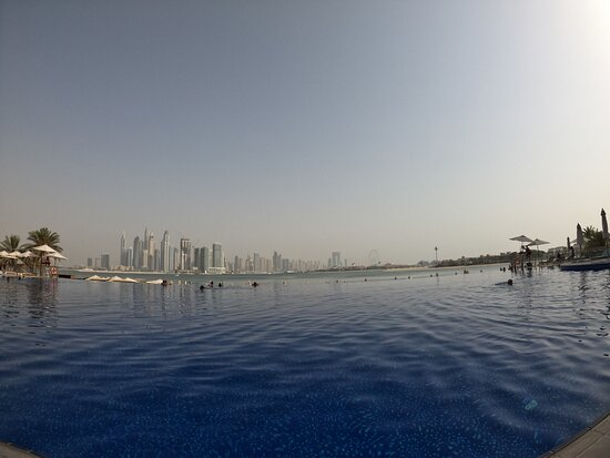 Infinity pool with Dubai Marina buildings in the background