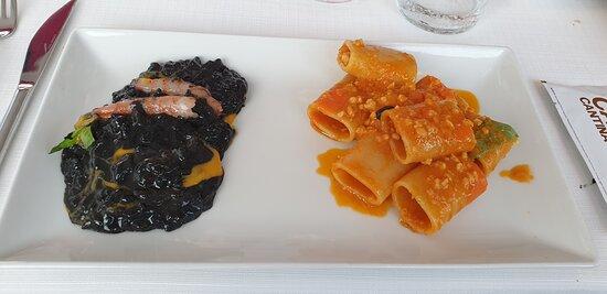 i paccheri con ragu di pesce e un risotto alla nero di seppie e il  gamberi rossi