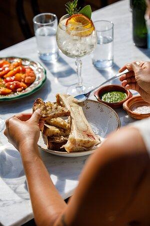 Roasted bone marrow, grilled sourdough bread, and chimichurri