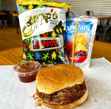 We have several kid's meals available (for ages 99 and under).   Kid's meals come with a capri sun or water, zapps chips or a 4oz side, and a mild BBQ Sauce.  Pictured is a Carson Special (Kid's pulled pork sandwich meal).