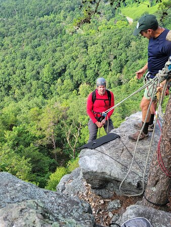 Rappelling down... over the edge! Lester managing safety belay from the top.
