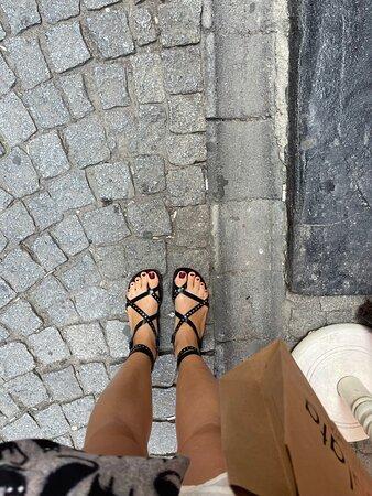 black leather sandals.
