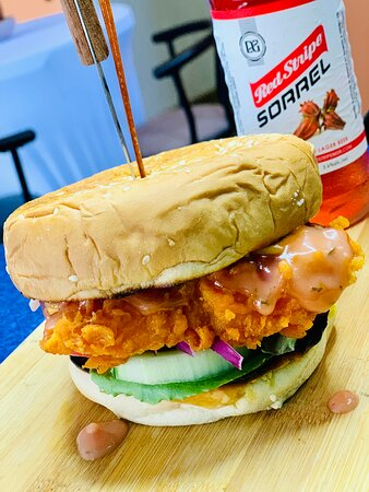 Pizzazz Fish sandwich served with a cold Red Stripe beer. Yum!