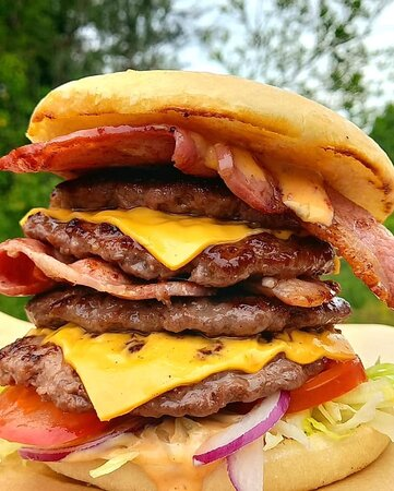 It's our biggest burger yet, consisting of; 4 x 3 oz steak burgers, double bacon, double cheese, tomato, lettuce and red onions, layered with burger sauce!