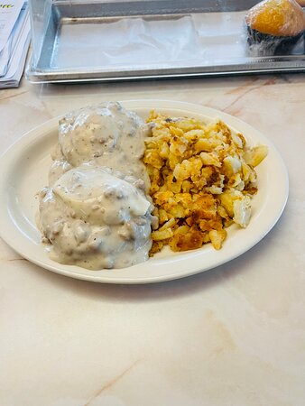 Country Eggs Benny with sausage gravy and home fries.