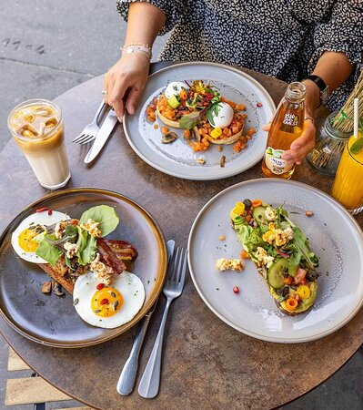 Avocado toast, soft coddled eggs, crispy bacon and salmon gravlax