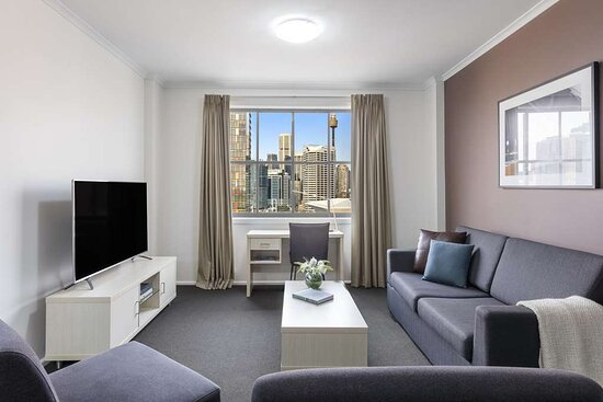 Interior view of lounge in Two Bedroom City Skyline Executive Apartment with city view