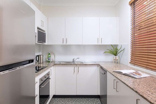 Interior view of kitchen in Two Bedroom City Skyline Apartment