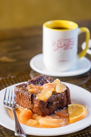 Deluxe Stuffed French Toast- Cinnamon swirl currant bread is made at a local bakery and is stuffed with your choice of apples or peaches. It is deep-fried in french toast batter and of course has whipped cream on top.