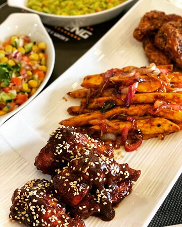Teriyaki Wings, Sautéed Sweetpotato Chips, Salsa with a twist. One word: Delicious 😋