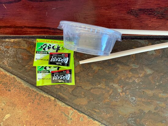 """Wasabi packets (two of four pictured) were 0.09 ounces each.  From which street corner did these come?  Note the single ginger """"container"""" as well."""