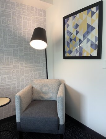 A stylish sitting area. The lamp provides diffuse lighting, which is wonderful.