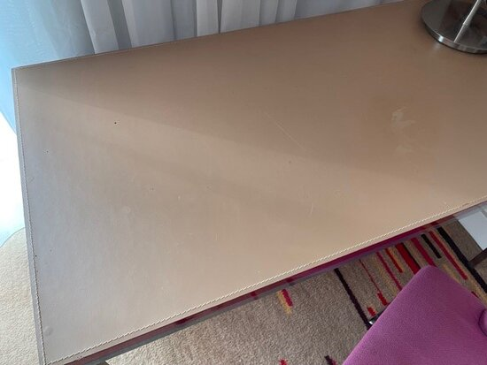 Dirty worksurface.  Found to be contain marks, dirt and was chipped