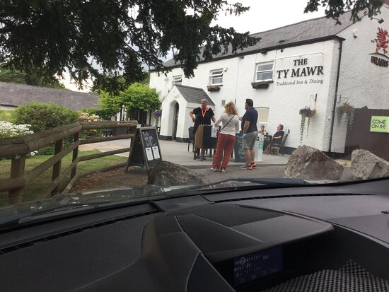 The pub with the land lady in the front plus visitors.