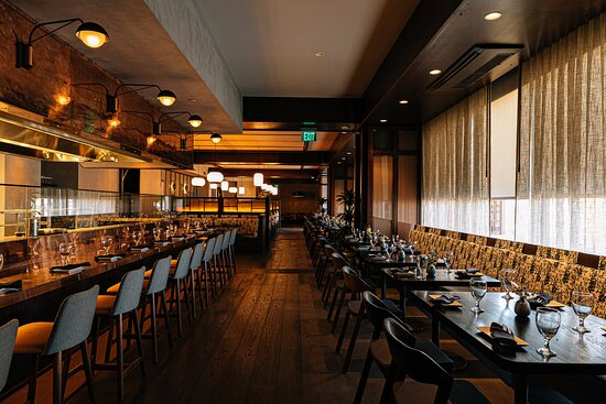 """Visitors can sip libations with views of the Charlotte city skyline or dine inside, where the Robata grill will act as a centerpiece for a unique dining experience. Natural elements and minimalist decor will pay homage to water — the Japanese translation of """"Mizu."""""""