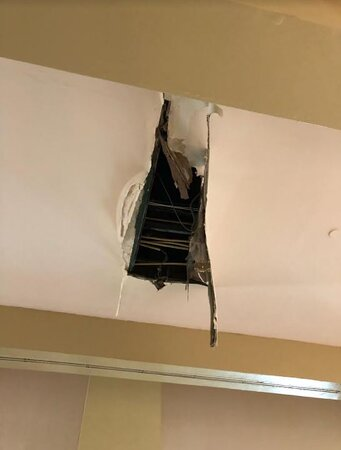 Hole in ceiling that opened up right before we left.