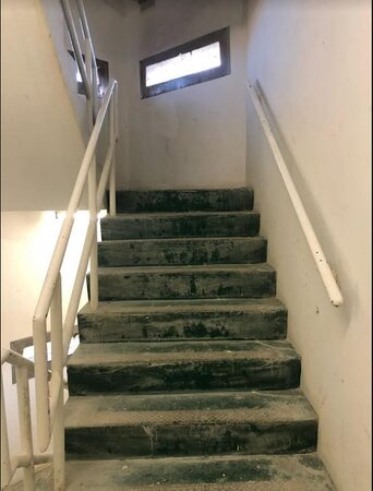 Stairway for guests, covered in construction debris