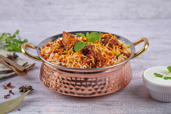 Lamb Biryani, basmati rice flavoured with fragrant spices such as saffron and layered with lamb and a thick gravy.