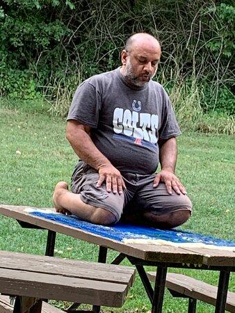 My Tanvir Sagri is offering prayers.
