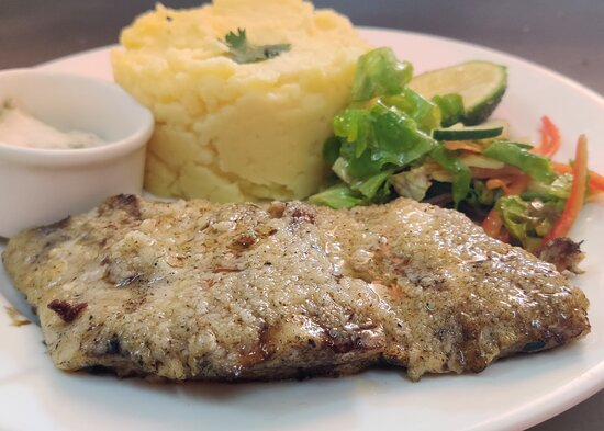 Fish fillet in lemon garlic sauce served with mashed potatoes