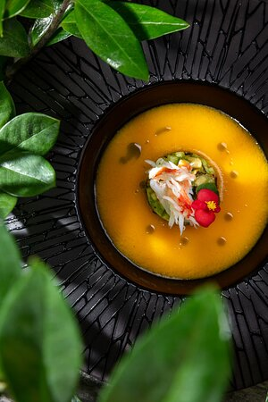 Yellow tomatoes soup with crab