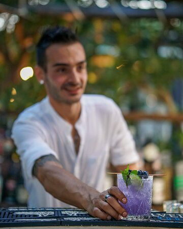 Our barman and one of our exclusive cocktails