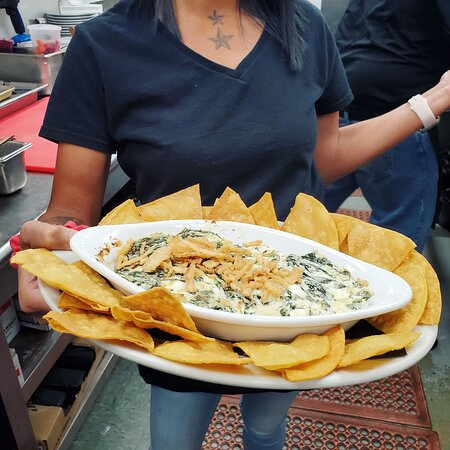 Spinach and artichoke dip with warm tortilla chips.