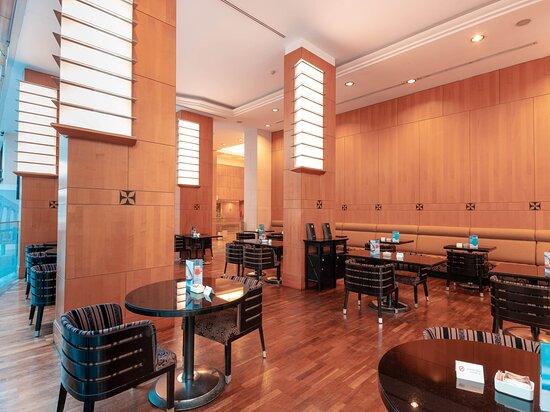L'Aroma Café  This is the place for you to get your morning coffee and treat yourself to a buttery croissant, delicious muffin, or light snack. Located in the Hotel Lobby makes it an extremely charming spot for your gatherings and quick meetings. L'Aroma caters to every cafe occasion with its warm friendly and accommodating service. Offering a menu with a variety of light options, desserts as well as a wide selection of coffee and beverage options.