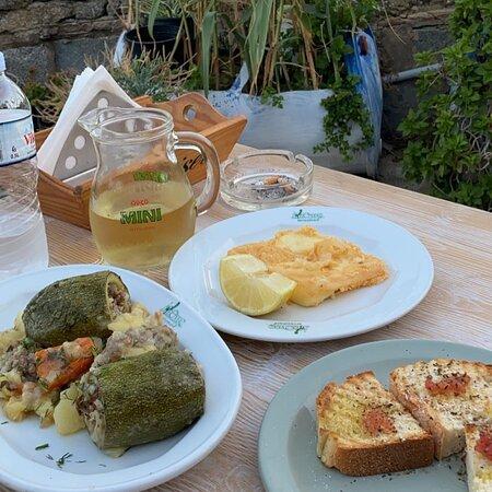Saganaki, bread and stuffed zucchini