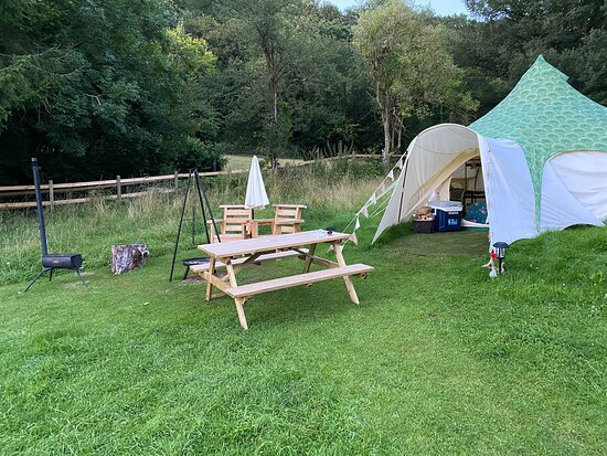 Our own little area complete with seating, log burner stove and bbq/fire pit