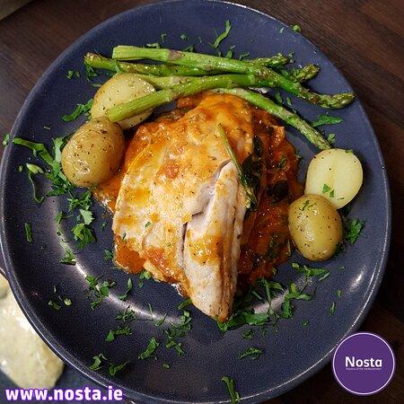 Sea Bass Fresh from English Market pan seared sea bass fillets served with roast veg & potatoes.